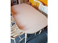 (Used) 4 chairs and a dining table