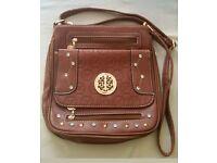 Tan coloured side bag, new