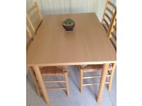 KITCHEN DINING FOUR LIGHT BEECH WOOD LADDER BACK CHAIRS with STRAW RUSH SEATS and RECTANGULAR TABLE
