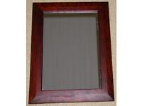 Small dark wood mirror