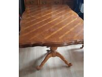 Solid wood dining table with 6 chairs.