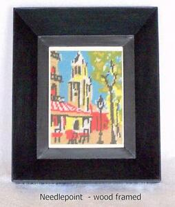 Picture frame with needlepoint, ready to hang
