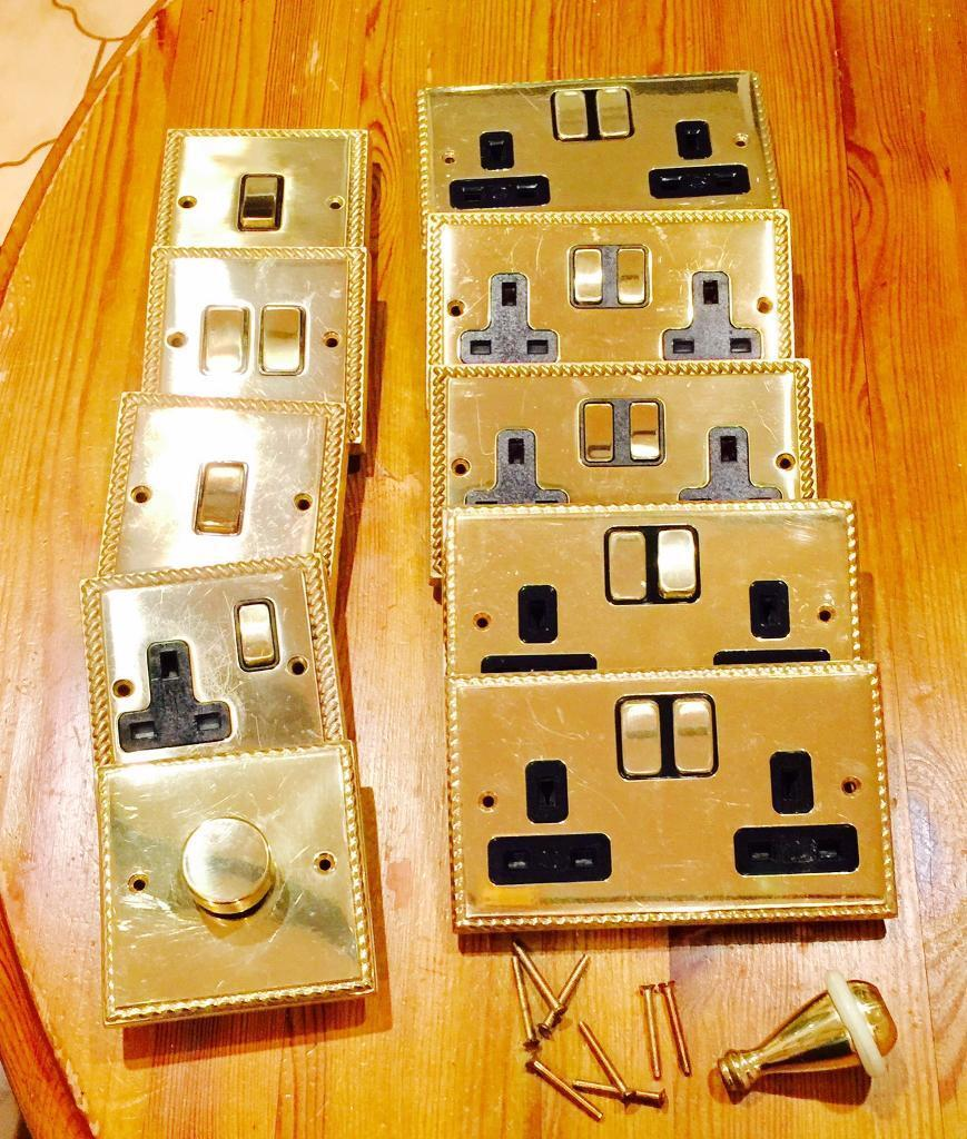 Selection of Georgian brass rope double and single sockets light switches