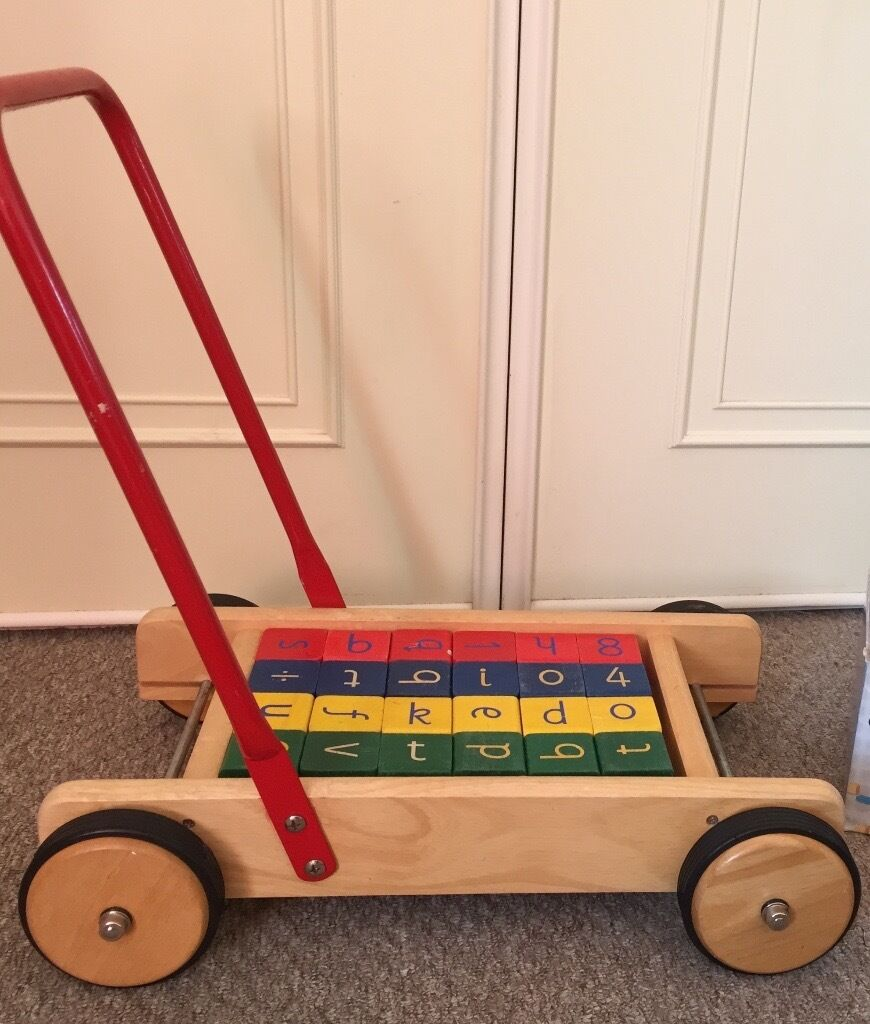 Baby walkerin Cambridge, CambridgeshireGumtree - Help your baby find his/her feet! Baby walker Trolley with 24 alpha numeric blocks Blocks in 4 colours provide extra stability as a counter weight to baby when pushing the trolley Play with the trolley or blocks independently In used and played with...