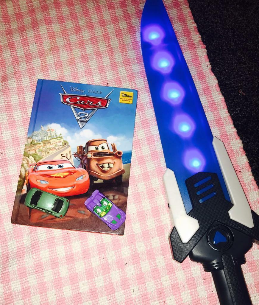 Book, sword and cars