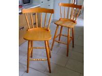 Two tall sturdy wooden bar or kitchen stools