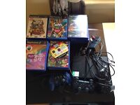 Slimeline playstation 2 with 32 games 3 controllers and. a 8 MBA memory card