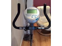 Infiniti magnetic resistance exercise bike, fully programmable, excellent condition, for sale - £90.