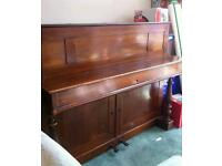 Wooden-framed piano free to collector