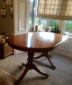 FURTHER REDUCED: Beautiful extendable oval oak dining table with tripod legs.
