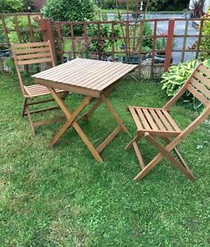 Beautiful wooden garden table and two chairs. As new condition