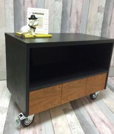 Retro wood and black cabinet on castors