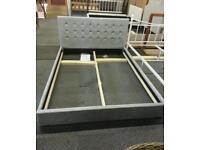A brand new stylish silver velvet king size bed frame.
