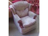 Fabric armchair with wooden elements in good condition
