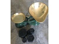 Old fashioned vintage kitchen scales, brass scoop and cast iron weights