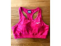 NIKE pink sports bra. size L. Slightly padded, excellent condition.
