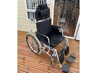 Lightly used wheelchair, easy fold, with leg & head rests & cushion