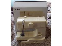 J L Mini sewing machine verry little use in original box. Approx 4 Years old.