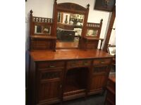 Solid brown mahogany, mirrored back sideboard