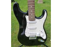 A 'Strat' style guitar in black. Light easy action. Good condition