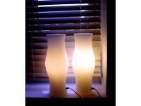two white glass table lamps