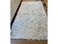 Silver threaded rug ( in good condition)
