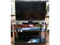 """Toshiba 32"""" TV and Toshiba DVD Player On Black Glass Stand"""