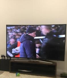 """Samsung 65"""" Curved UHD 4K HDR Ready Smart TV WITH Samsung Soundbar, Wall Bracket and TV Stand!"""