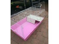 Pink indoor cage by ferplast for rabbits & guinea pigs with stand .