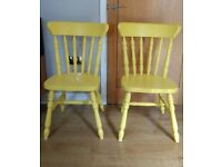 2 yellow wooden chairs