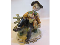 A Capodimonte Tramp man sitting on bench figurine, stamps on the base pottery porcelain collectible