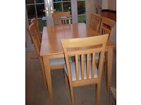 Extending dining table and six chairs.