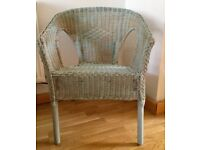 Small wicker chair painted with duck egg blue Annie Sloan chalk paint.