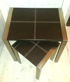 Two brown leather tables with chromed legs