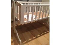 White, wooden crib with nearly new mattress