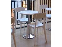 3 Italian indoor cafe tables. White wipe clean table top 60cm dia. 2.5cm thick. Chrome pedestal.
