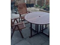 SOLID WOODEN ROUND TABLE with TWO SOLID WOODEN FOLDING CHAIR'S