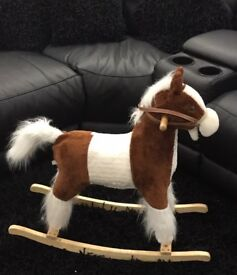 Rocking horse with sound effects/music