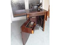 Singer '66' sewing machine in cabinet, with attachments.