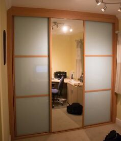 Large fitted wardrobe with 3 sliding doors