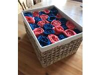 14 blue and 12 coral pink pashminas, including wicker basket presentation box.
