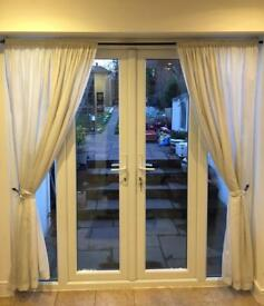 Lined white net curtains