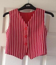 Red and white striped waistcoat and black cap