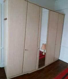 Very tidy cream wardrobe from three parts