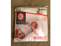 Holiday - Snoozzz Sleep Wrap Positioner - Baby Can Sleep Safely On A Bed, No Need For Travel Cots.