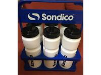 Sondico water bottles as new. 6 pack with carrier. 2 packs available