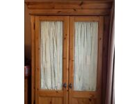 Shreiber dark pine double wardrobe with half glass doors. Used but looked after. Will dismantle.