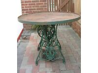 Vintage sewing machine base with custom made metal table top