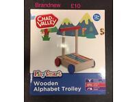 BRANDNEW wooden alphabet trolley