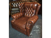 Brown leather Chesterfield wingback chair